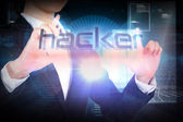 Businesswoman presenting the word hacker — Stock Photo