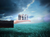 Business team against blue sky over field — Stock Photo