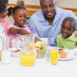 Happy family having breakfast together in the morning — Stock Photo #50043061