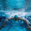 Fit swimmer training by himself — Stock Photo #50043819