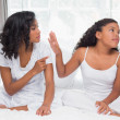 Mother and daughter having an argument on bed — Stock Photo #50043907