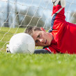 Goalkeeper in red making a save — Stock Photo #50044175