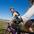 Active happy couple on a bike ride in the country — Stock Photo