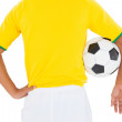 Football player in yellow holding ball — Stock Photo #50044741