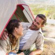 Outdoorsy couple smiling at each other inside their tent — Stock Photo