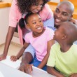 Happy family using the laptop together — Stock Photo #50045545