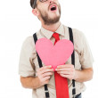 Geeky hipster crying and holding heart card — Stock Photo #50045621
