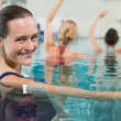 Fitness class doing aqua aerobics — Stock Photo #50046123
