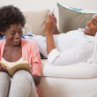 Couple together reading book and using smartphone — Stock Photo #50046315