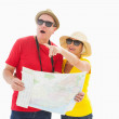 Happy tourist couple using map — Stock Photo
