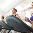 Row of people working out on treadmills — Stock Photo #50046845
