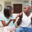 Unhappy couple having an argument on the couch — Stock Photo #50046985