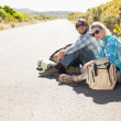 Couple sitting on road waiting for lift — Stock Photo #50047059