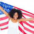 Pretty cheering girl in white top holding american flag — Stock Photo #50047073