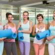 Smiling women in fitness studio before yoga class — Stock Photo #50047953