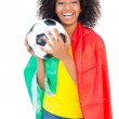 Pretty football fan with portugal flag holding ball — Stock Photo #50047999