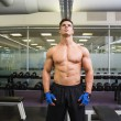 Serious shirtless muscular man in gym — Stock Photo #50048057