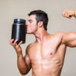 Muscular man kissing nutritional supplement — Stock Photo #50048615
