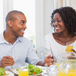 Couple enjoying a healthy meal together smiling at each other — Stock Photo #50048695
