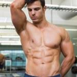 Serious shirtless muscular man in gym — Stock Photo #50048901