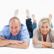 Happy mature couple lying and smiling — Stock Photo #50049021