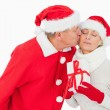 Festive couple smiling and holding gift — Stock Photo #50049189