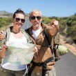 Hiking couple looking at map on the road — Stock Photo #50049693