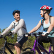 Active couple going for a bike ride in the countryside — Stock Photo #50049817