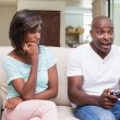 Woman sitting next to her boyfriend playing video games — Stock Photo #50049893