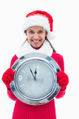 Beautiful festive woman holding clock — Stockfoto
