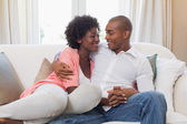 Happy couple relaxing on the couch — Foto Stock
