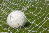 Football at the back of the net  — 图库照片