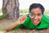 Pretty environmental activist holding magnifying — Stock Photo