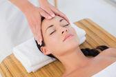 Brunette enjoying head massage — Stock Photo
