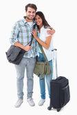 привлекательная молодая пара собирается на каникулы — Стоковое фото