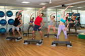 Fitness class doing step aerobics — Stock Photo