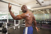 Rear view of a shirtless bodybuilder — Stock Photo