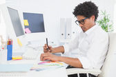 Hipster designer working at his desk — Stock Photo