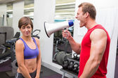 Personal trainer shouting at client through megaphone — Stock Photo