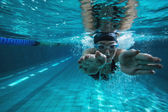 Athletic swimmer training on her own — Stock Photo