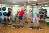 Fitness class doing step aerobics — Foto Stock