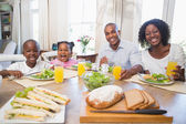 Happy family enjoying a healthy meal together  — Stockfoto