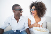 Couple sitting on couch together watching 3d movie — Stock Photo