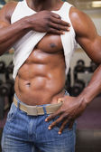 Mid section of a muscular man in gym — Stock Photo