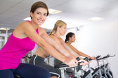 Spin class working out in a row — Stock Photo