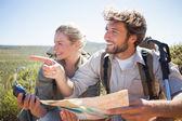 Couple taking break on mountain terrain — Stock Photo