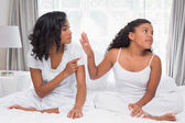 Mother and daughter having an argument on bed — Stock Photo