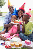 Happy family celebrating a birthday — Stock Photo