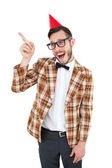 Geeky hipster in party hat pointing — Stock Photo