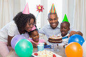 Happy family celebrating a birthday together at table — Стоковое фото